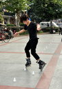 Pengzhou, China: Teen Rollerblading Royalty Free Stock Photo