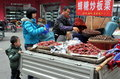 Pengzhou, China: Vendor Selling Fruit & Nuts Royalty Free Stock Images