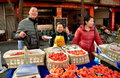 Pengzhou china vendors selling strawberries chinese street baskets of fresh at an outdoor market Stock Photos