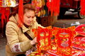 Pengzhou, China: Woman with Chinese New Year Decorations Stock Image