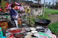 Pengzhou, China: Woman Cooking at Wedding Luncheon Royalty Free Stock Photo