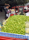 Pengzhou, China: Woman Selling Fruits Royalty Free Stock Photo
