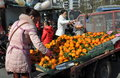 Pengzhou china woman selling oranges fresh local from the back of her flatbed truck at the entrance to park in Royalty Free Stock Images