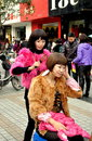 Pengzhou, China: Woman Styling a Wig Royalty Free Stock Photo