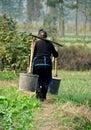 Pengzhou, China: Woman with Water Pails Royalty Free Stock Photo