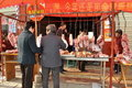 Pengzhou, China: Women Buying Meat from Butcher Royalty Free Stock Image
