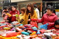 Pengzhou china women shopping for wallets on sale being sold by a street vendor on li ren jie street in Stock Images