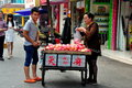 Pengzhou china young man selling apples from the back of his bicycle cart on li ren jie street in Stock Photos