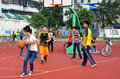 Pengzhou china youths playing basketball a group of chinese on a court in national stadium in Royalty Free Stock Images
