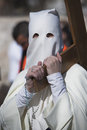 Penitent carried a wooden cross in a procession of holy week seville andalusia spain Royalty Free Stock Images