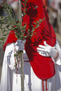 Penitent with a crosier carried olive branches during a procession of holy week on palm sunday spain Royalty Free Stock Images