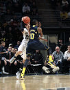 Penn State's Nick Colela is fouled by  Michigan's Tim Hardaway Stock Photography