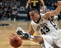 Penn state s ross travis dives for a loose basketball Stock Photo