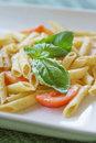Penne al pomodoro fresco italian dish pasta with fresh tomato and basil Royalty Free Stock Photography