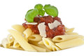 Penne in bowl decorated with fresh basil Royalty Free Stock Photography