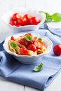 Penne pasta with cherry tomatoes and basil Stock Images
