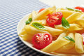 Penne pasta with cherry tomatoes and basil closeup Royalty Free Stock Images