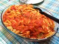 Penne pasta covered with tomato sauce in glass bowl Royalty Free Stock Photo