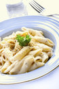 Penne pasta cream sauce and cheese Stock Photo