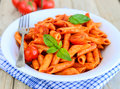 Penne pasta italian arrabiata basil Royalty Free Stock Image