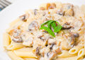 Penne pasta with mushroom sauce on plate Royalty Free Stock Photography