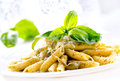 Penne pasta pesto sauce italian cuisine Royalty Free Stock Photo