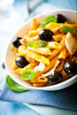 Penne pasta with pesto sauce and olives Stock Images