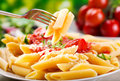 Penne pasta plate of with tomato sauce Stock Images