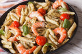 Penne pasta with shrimp, tomato and pesto on a plate closeup. Ho Royalty Free Stock Photo