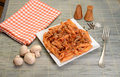 Penne pasta with tomato mushrooms and basil Royalty Free Stock Images