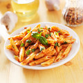Penne pasta in tomato sauce smothered Stock Photography