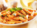 Penne pasta in tomato sauce smothered Royalty Free Stock Photography