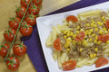 Penne regatta with tuna and corn tomatoes Royalty Free Stock Photography