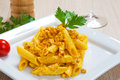Penne with speck and saffron on a dish Royalty Free Stock Image