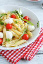 Penne on a white plate with tomatoes and mozzarella cheese italian food close up Stock Photography