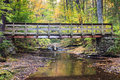 Pennsylvania bridge over creek in autumn crooked the boston run area near adams falls the red rock mountain contrasted against the Stock Photo