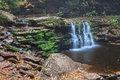 Pennsylvania cayuga waterfall in ricketts glen state park in the foot has minimal water flow enabling the visitor to see the Royalty Free Stock Photography
