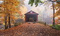 Pennsylvania josiah hess covered bridge a foggy autumn landscape of the which spans the huntington creek in orangeville built in Stock Photo