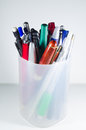 Pens in holder over white background Royalty Free Stock Photography