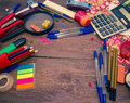 Pens, notebook, magnifier, calculator and pencils. Royalty Free Stock Photo