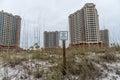PENSACOLA, FLORIDA - APRIL 14, 2016: Keep of Dunes sign in Pensacola Beach. Portofino Tower in Background Royalty Free Stock Photo