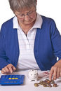 Pensioner counting money Royalty Free Stock Photos