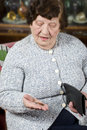 Pensioner counts her last money Royalty Free Stock Photo