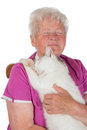 Pensioner hugging her white tomcat Royalty Free Stock Images