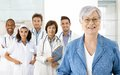 Pensioner and medical team happy senior women with in background Royalty Free Stock Images
