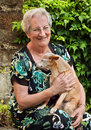 Pensioner with pet dog Royalty Free Stock Photography