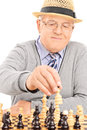 Pensioner playing chess isolated on white background Stock Photo