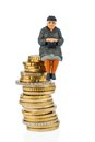 Pensioner sitting on a pile of money symbolic photo for pensions retirement old age security Royalty Free Stock Images