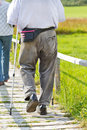 Pensioner walking on a wooden path in nature Stock Images