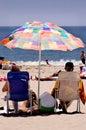 Pensionering: Een dag bij het Strand Stock Afbeeldingen